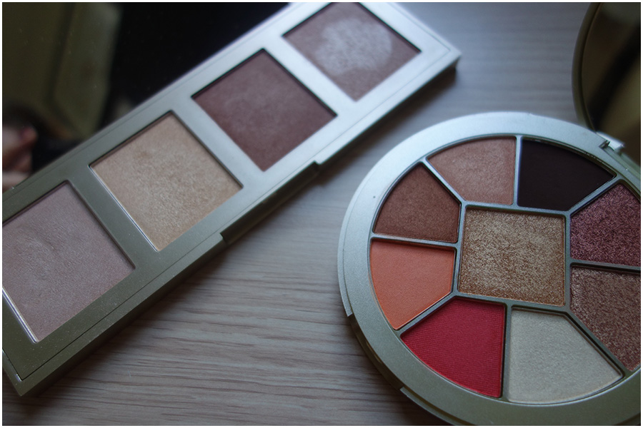 A photo of the highlighter palette and eyeshadow palettes next to each other open.