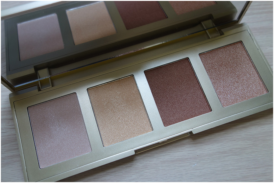 The palette open, it shows the four different highlight colours and the mirror standing up in the lid