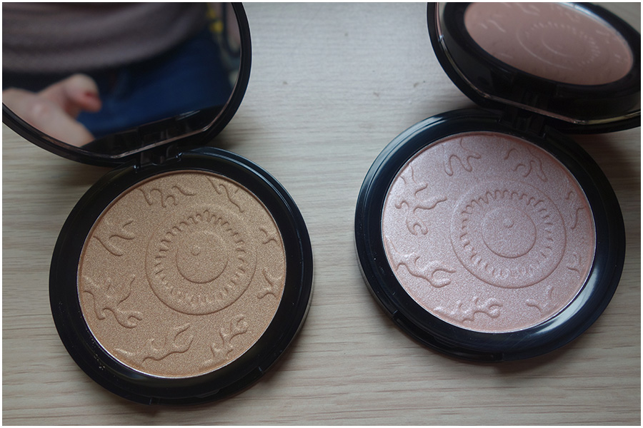 The two compacts open to show the mirror and product inside. On the left is a bronze shimmery highlight and on the right is a pale pink. Each of them has a cartoon eyeball pattern embossed on the product itself.