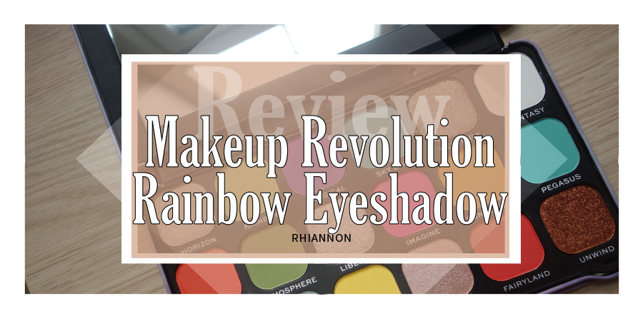 Makeup Revolution Rainbow Palette title image. Behind the text box is a photo of the palette open, showing some of the eyeshadow colours inside