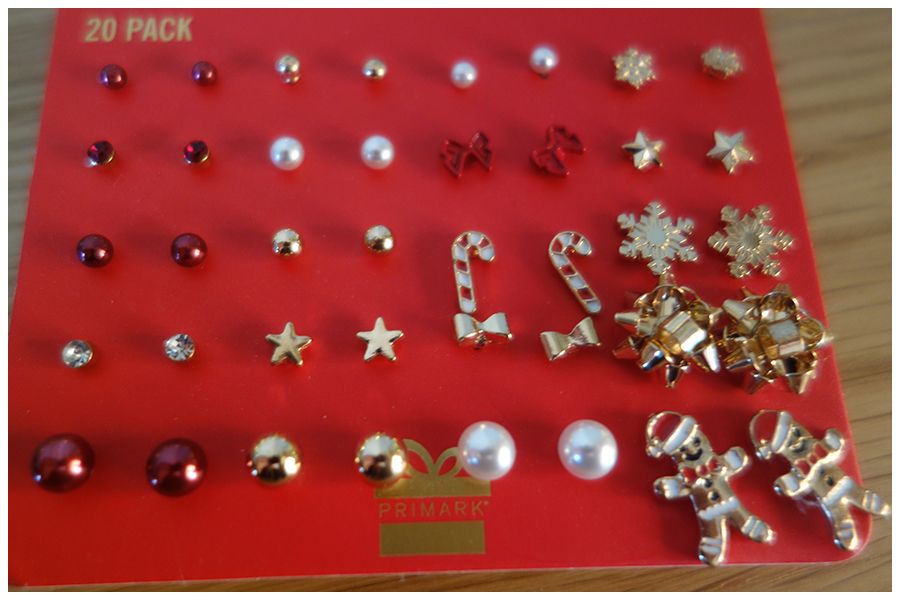The pack of twenty stud earrings, a mix of plain round studs, snowflakes, gingerbread men, candy canes and bows