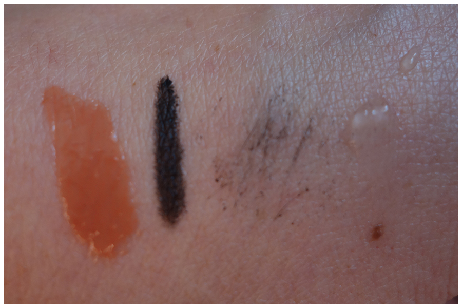 Swatches of four of the products in the set. Left to right is the Gloss Angeles lip gloss, Always on Gel Eyeliner, Full Exposure Mascara and Photo Finish Primer