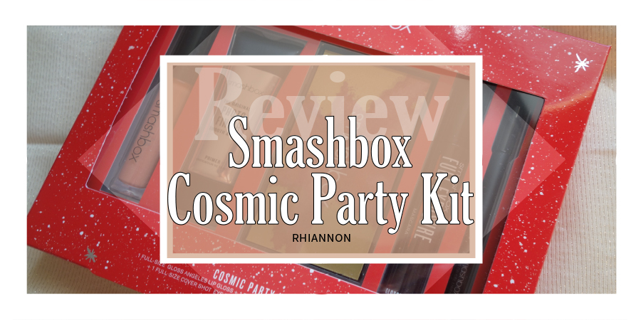 The Smashbox Cosmic Party Kit title image. Behind the text box is a photo of the gift set unopened, showing the products in a red box with dots and star doodles on it in white
