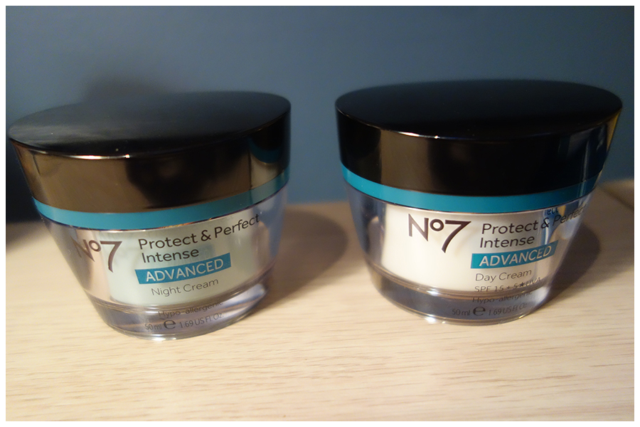 The two jars of the moisturisers. On the left is the night cream which has a greener layer inside the glass of the jar and the day cream that has a white layer inside, though both of the creams are white.
