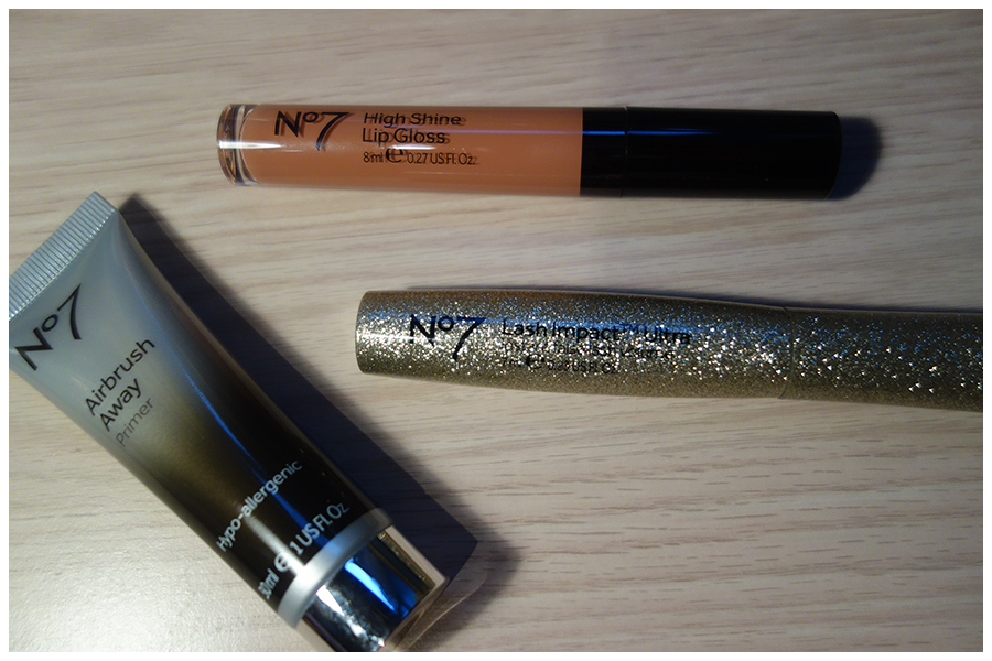 Photo of the Airbrush away primer tube, the lip gloss tube and the Mascara packaging, which is gold and glittery