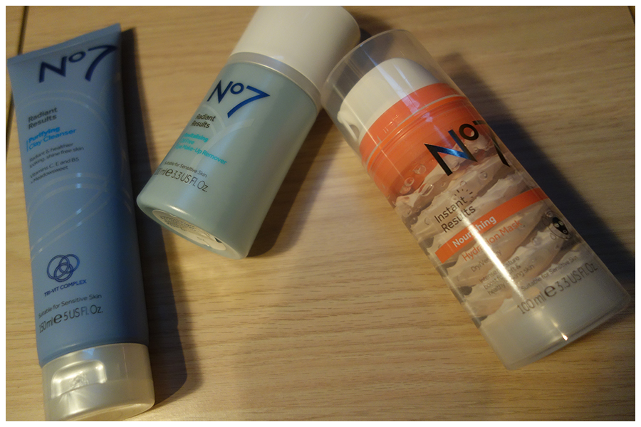From left to right are a large squeezy tube with the cleanser in it, a bottle of the eye makeup remover and the pump bottle that has the mask in it.