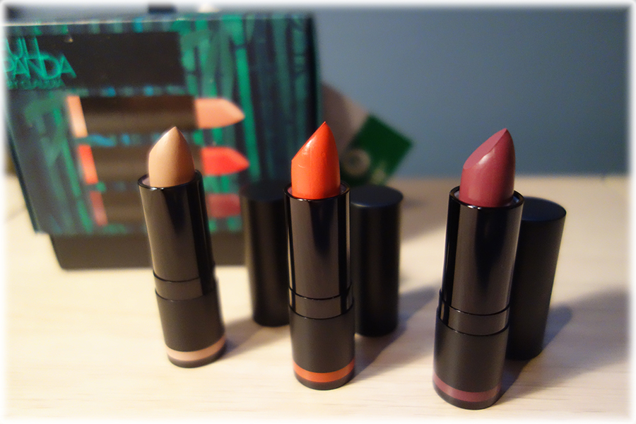 The All Week Long lipsticks out of their box, it shows the tubes with the lids off and the lipstick twisted up a bit