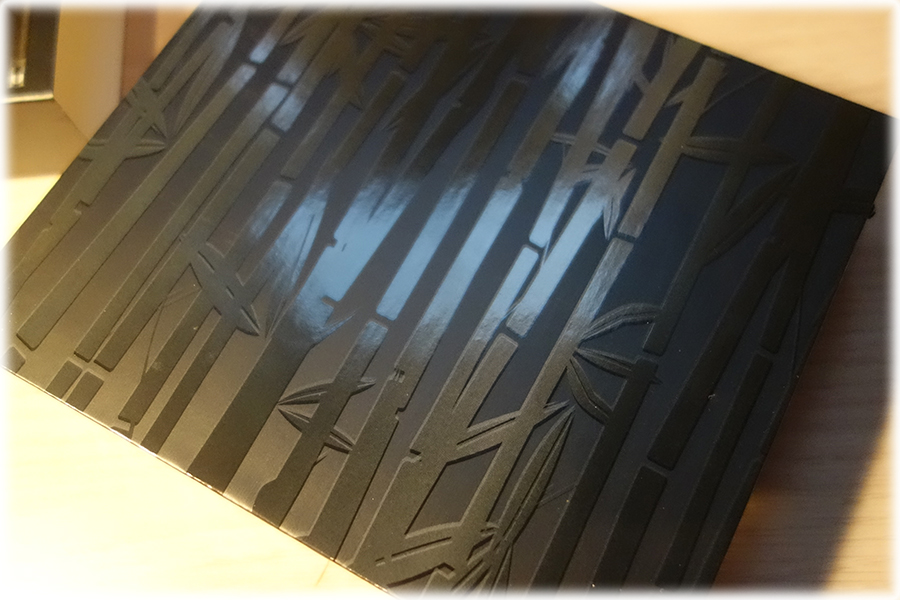 The outside box from the Must Have Kit. it's a matte black box with shiny black finish bamboo pattern on it