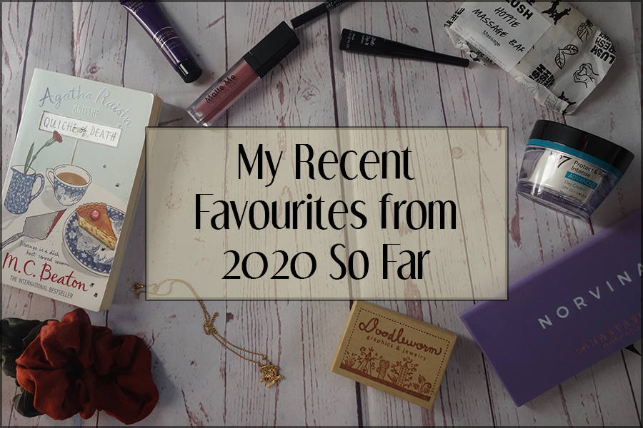 The title image for the blog post. Behind the text box is a photo of a range of products spread on a white wood floor background. There's makeup, skincare, books and accessories.
