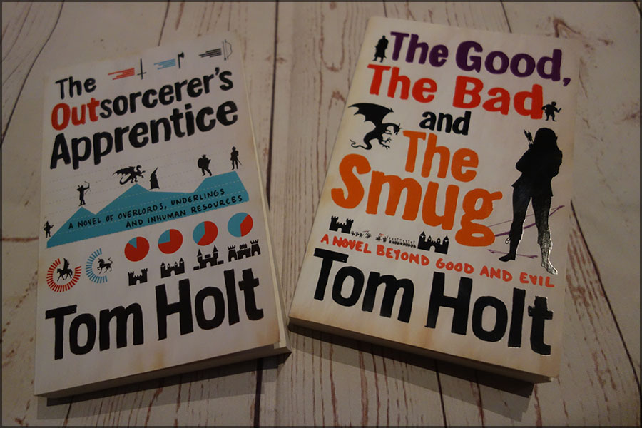 The front covers of The Outsorcerer's Apprentice and The Good, the Bad and the Smug. They each have cartoon outlines of magical creatures and castles with the title in bold text